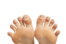 Female Foot And Smiles Drawn On The Toes