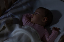 Baby Sleeping On The Bed / Adorable Baby Sleeping At Night. Little Girl In Pajama Taking A Nap In Dark Room.