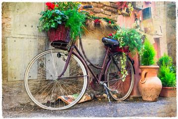 Panel Szklany Podświetlane Do przedpokoju Vintage old bike - charming street decoration.Artwork in retro style