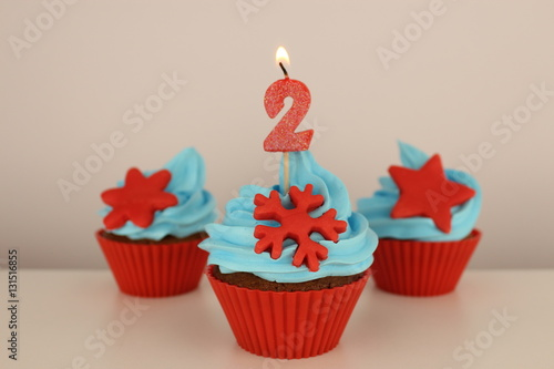 Number 2 Candle On Red Cupcake