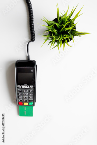 Fototapety, obrazy: payment terminal with card on white background top view