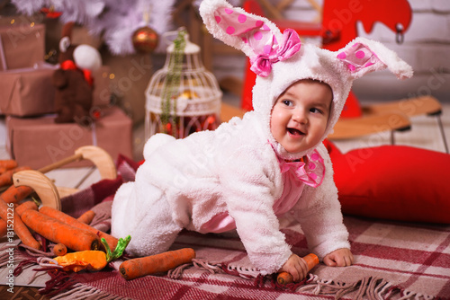 Cute Young Toddler Girl Wearing A Bunny Rabbit Costume Chewing On A
