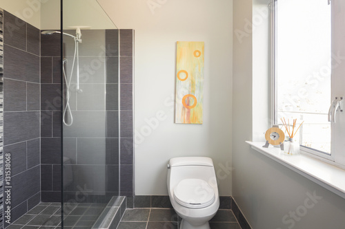 Bathroom With Open Glass Shower And Large Titles.
