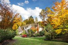 Suburban Home In Autumn Sunshine As The Leaves Turn Orange & Yellow