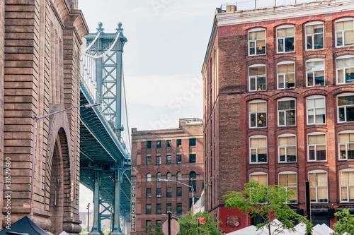 Statues of dog photographers under Brooklyn Brifge