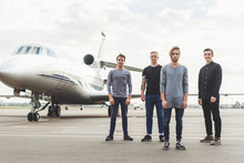 Four Friends Waiting For Take-off Near Plane