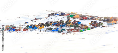 Photo Stands Pole Colorful cabins on the hill covered in snow, Aasiaat city, Green
