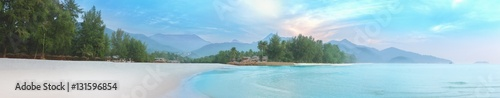 Sea of mist and sunrise at white sand beach of Koh Chang. Beautiful tropical Thailand island panoramic for holiday vacation background concept.