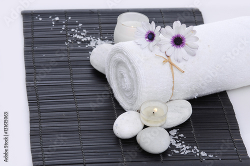 Poster Spa Spa setting with candle, towel on mat,with salt