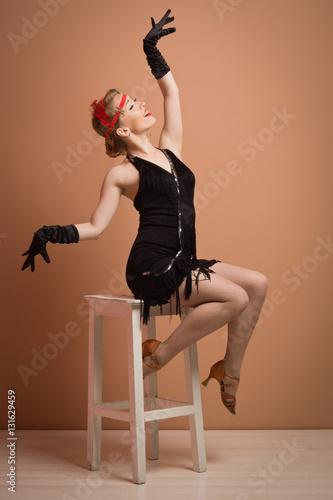 f9289c31f128 pretty actress in black retro dress with headband - Buy this stock ...