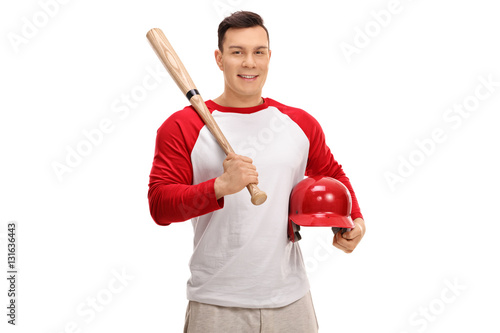 Photo  Happy baseball player holding a bat and a helmet