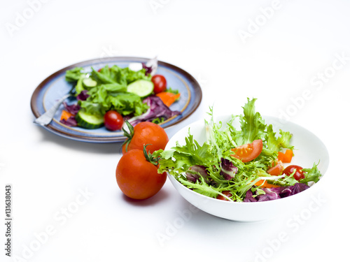 Tuinposter Groenten plate and bowl of salad