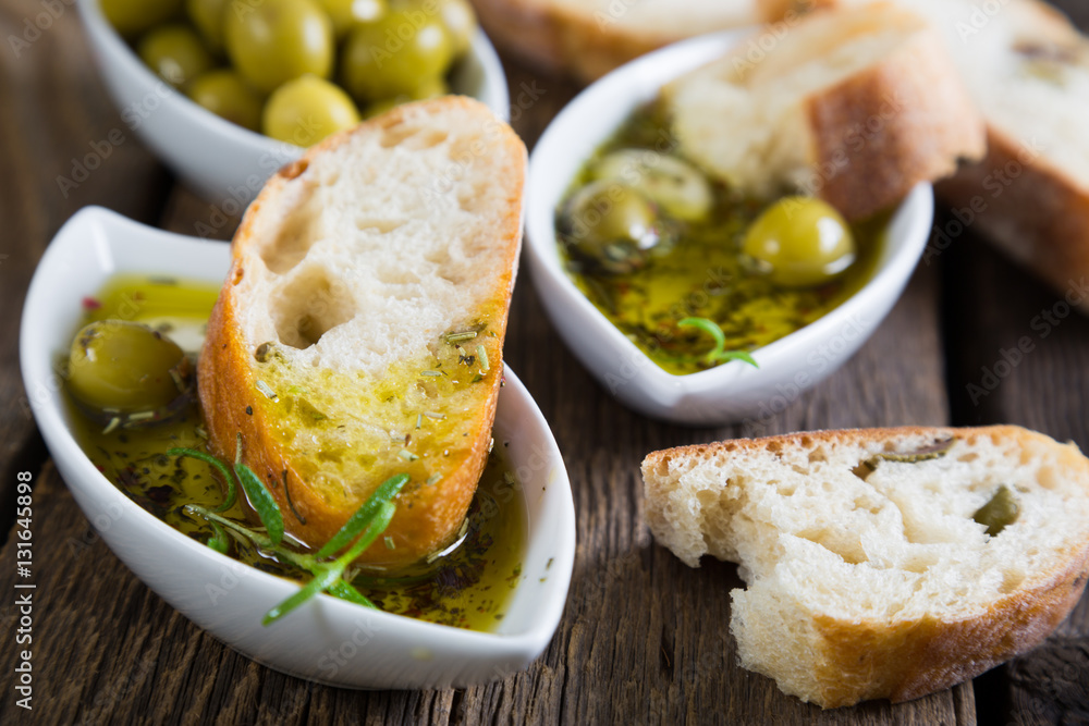 Fototapety, obrazy: The bread dipped in olive oil with herbs and spices
