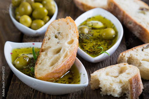 The bread dipped in olive oil with herbs and spices