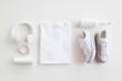 Leinwanddruck Bild - Blank stuff on white background. Template for design presentations. Branding Mock-Up. Shirt, sneakers, headphones, bottle.