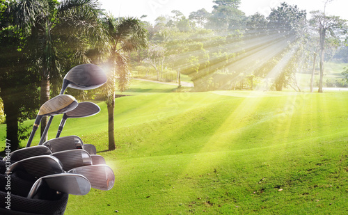 Golf clubs drivers over beautiful green course at the sunset, sunrise time Canvas Print
