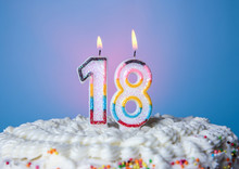 Tasty Cake With Candles For Eighteenth Birthday On Blue Background
