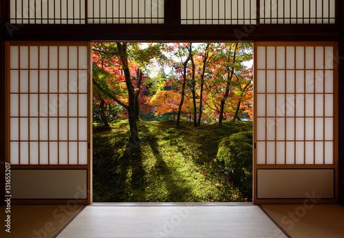 Foto op Plexiglas Japan Japanese sliding wood doors open to an autumn sight of fallen yellow ginkgo leaves