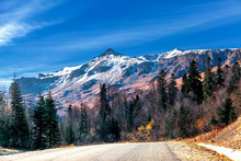 Big Mountain In Autumn With Yellow Trees And Snow-capped Mountain View From The Road Serpentine Caucasus