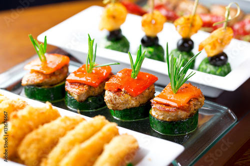 Leinwand Poster set of finger food - zucchini, grilled pork, red pepper and rosemary