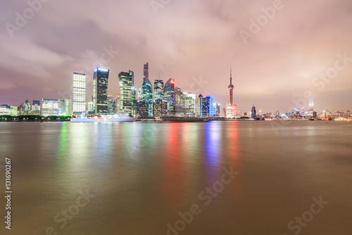 Garden Poster London Shanghai skyline and modern cityscape at night,China