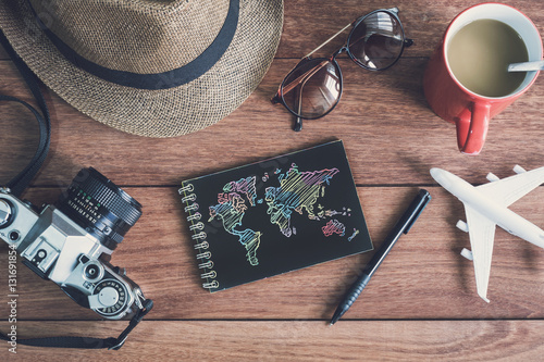Obraz Traveler's accessories and items with black notebook and copy sp - fototapety do salonu