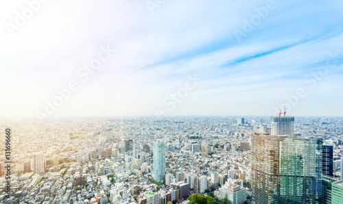 Poster Kyoto Business and culture concept - panoramic modern city skyline bird eye aerial view under dramatic sun and morning blue cloudy sky in Tokyo, Japan