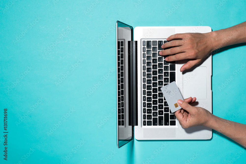 Fototapeta Top view of male hands making online payment