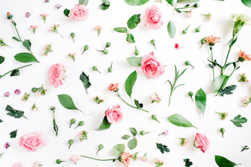 Fototapeta Na sufit Floral pattern made of pink and beige roses, green leaves, branches on white background. Flat lay, top view. Valentine's background