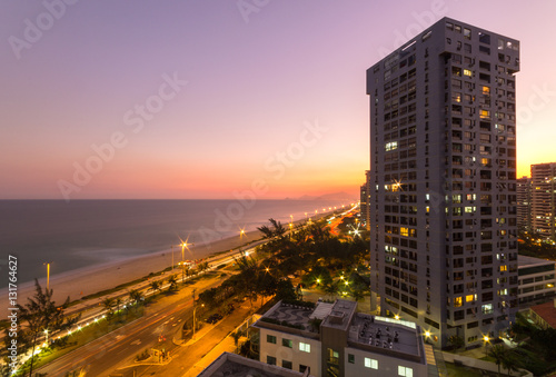 View of the edge of Barra da Tijuca with sunset in the background Poster