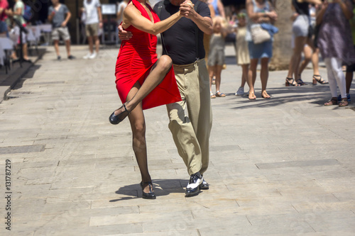 Poster Buenos Aires Street dancers performing tango in the street among the people