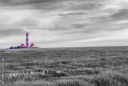 Spoed Foto op Canvas Noordzee Rot-Weißer Leuchtturm