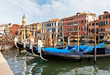 Venetian gondolas on the Grand Canal near the Rialto Bridge
