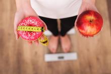 Diet. Woman Measuring Body Wei...
