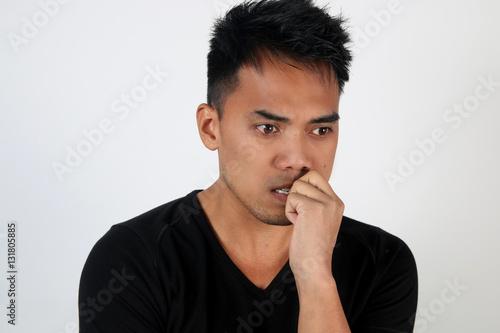 Fotografía  Portrait d' un jeune homme inquiet