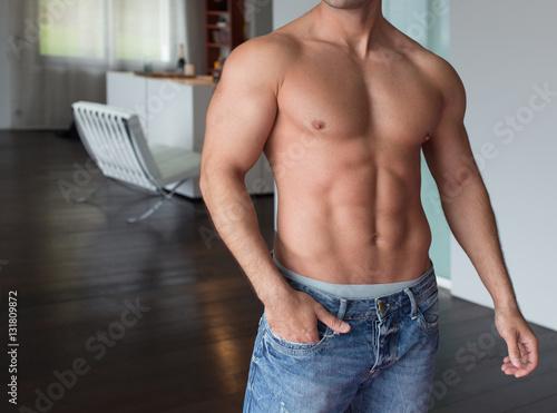 Fotografie, Obraz  Sexy man body posing indoor