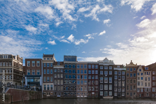 Photo  Netherlands, Amsterdam - piece of canal facade with typical houses against blue