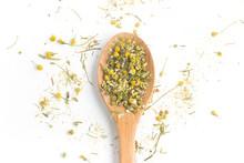 Dry Camomile Tea Into A Spoon