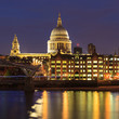 Millennium Bridge leading to Saint Paul's Cathedral during sunset