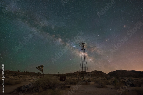 Fotografering  Milky Way Galaxy rising behind an old windmill
