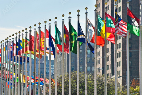Photo sur Toile New York City Flags of all nations outside the UN in New York City.