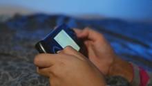 Teen Girl Playing Portable Vid...