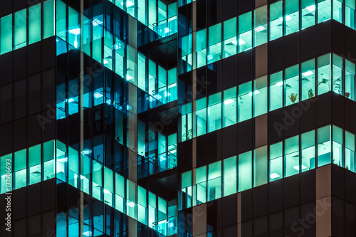 Modern office windows of skyscraper glowing at night