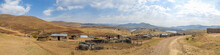 Panorama Of Simple Stone And Tin Huts In A Village Near Katse Dam In The Mountain Kingdom Of Lesotho, Africa