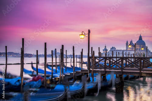 Foto op Plexiglas Venetie Gondolas at St. Mark's Square in Venice at sunset