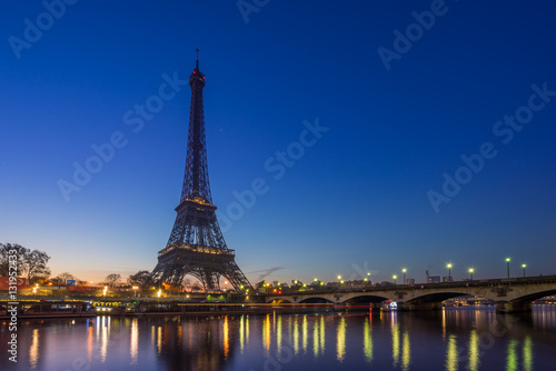 The Eiffel tower at sunrise in Paris