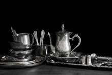 Silver Dishware On Table And B...
