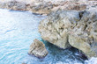 Cliff, Rocks by the sea with waves of the Mediterranean sea next