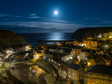 The Picturesque Fishing Village Of Staithes By Moonlight, Yorkshire, England.