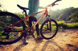 ready for riding mountain bike on sunrise forest trial